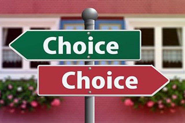 "green and red signs that read ""choice"""