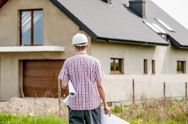 Architect in front of a house